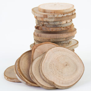 This image shows natural wood slices stacked up on a white background