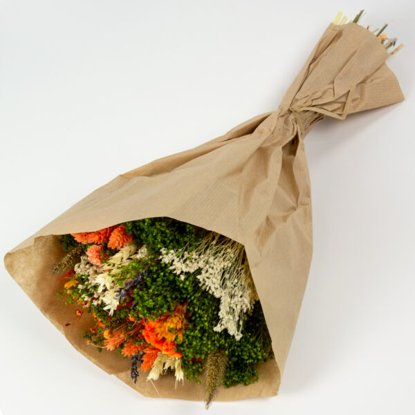 This image shows a side view of a Dried Sorriso Mixed Bouquet on a white background