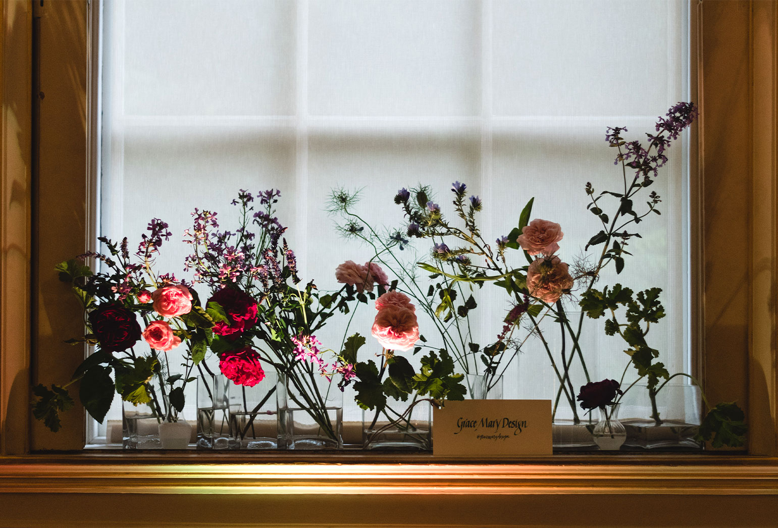 flowers on gold window sill