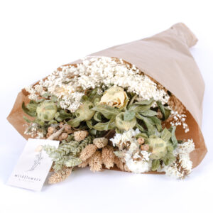 This image shows a pre-made wildflower bouquet, contain a mix of flowers with natural, earthy hues.