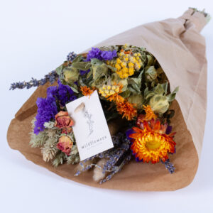 This image shows a pre-made wildflower bouquet, contain a mix of flowers with orange hues.