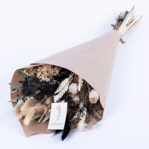 This image shows a pre-made wildflower bouquet, contain a mix of natural and bleached flowers and stems.