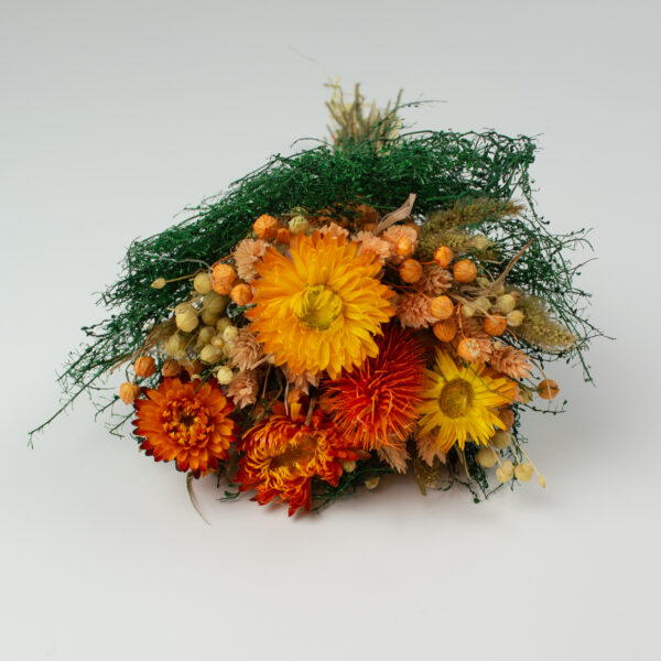 This image shows a front view of a Dried Giardino Mixed Bouquet on a white background