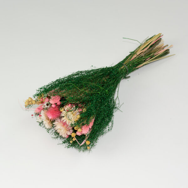 This image shows a side view of a Dried Giardino Mixed Bouquet on a white background