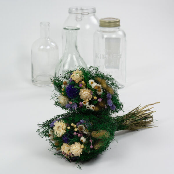 This image shows a styled view of a Dried Giardino Mixed Bouquet on a white background
