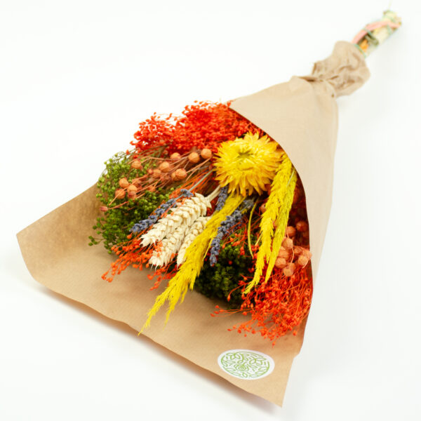 This image shows a summer bouquet in yellow and orange, laid on a white background.