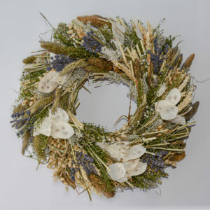 This image shows a fully made up dried flower wreath, containing a mix of honesty, lavender, grasses and cereal foliage.