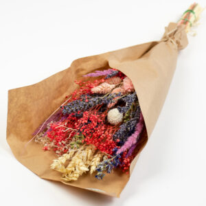 This is an image of a mixed dried flower summer bouquet wrapped in kraft paper.