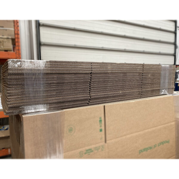 This is an image of the flat packed boxes, in their wrapping, ready to be dispatch.