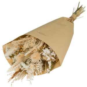 this is an image of a large sized wildflower bouquet with a white theme, wrapped in brown kraft paper and laid on a white background.