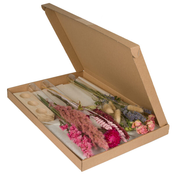 This image shows a small box, containing a mixture of dried flower stems, three glass vials in which to display them, and a corresponding wooden block with three recesses, designed for the vials to be displayed.