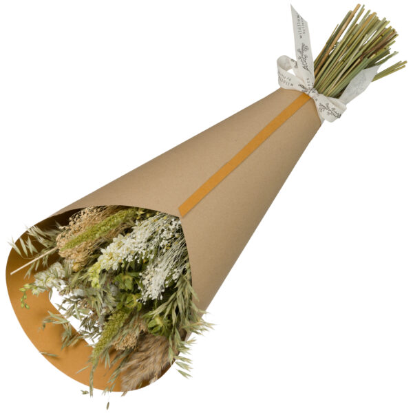 This image shows a large, wrapped. natural,bouquet laid on a white background.
