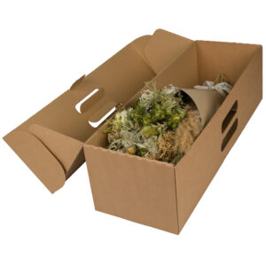 This image shows a large, wrapped, natural bouquet in a cardboard shipping box, laid on a white background.