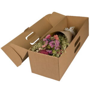 This image shows a large, wrapped, pink bouquet in a cardboard shipping box, laid on a white background.