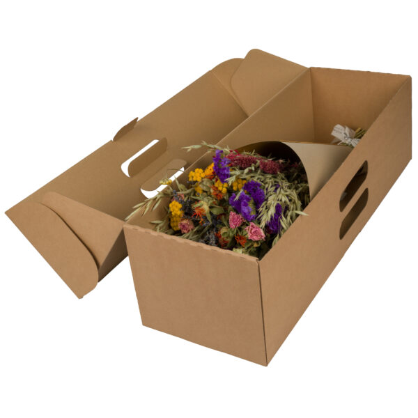 This image shows a large, wrapped, multi coloured bouquet in a cardboard shipping box, laid on a white background.