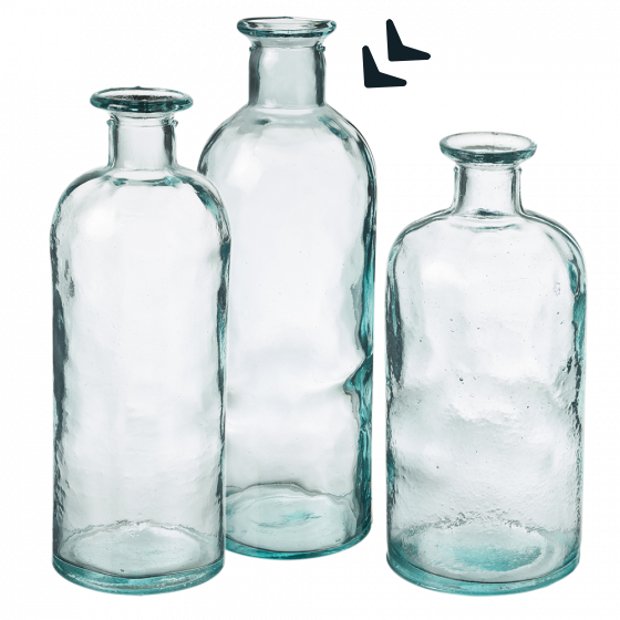 This image shows a group of three glass bottles of different sizes, in the same style, against a white background