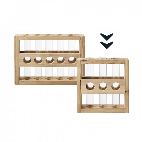 This image shows two different test tube holders against a white background with an arrow pointing to the one on the right that contains three tubes